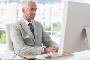 happy businessman working on computer